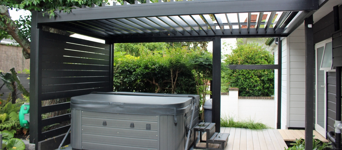 Bask freestanding louvre roof sheltering a spa pool on a back deck