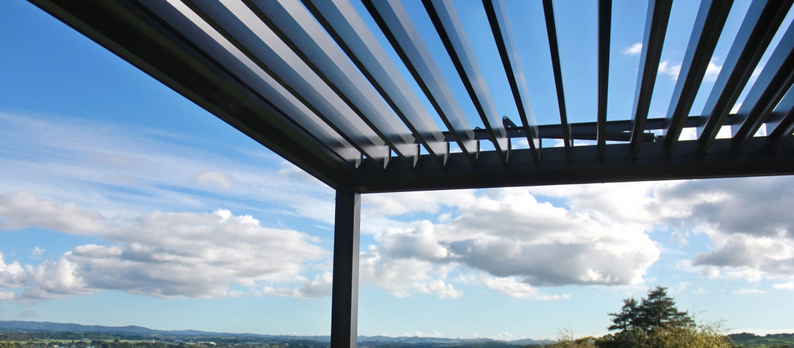 Bask louvre roof open to let the light in looking over Auckland view