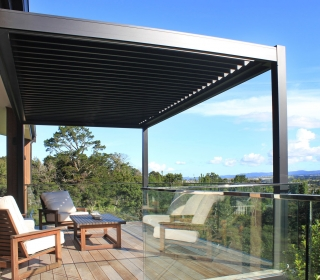 Bask louvre roof frames this stunning Auckland view perfectly