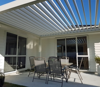 Freestanding Bask Louvre Roof fitted on North Facing Patio open on winters day to let the sunlight in