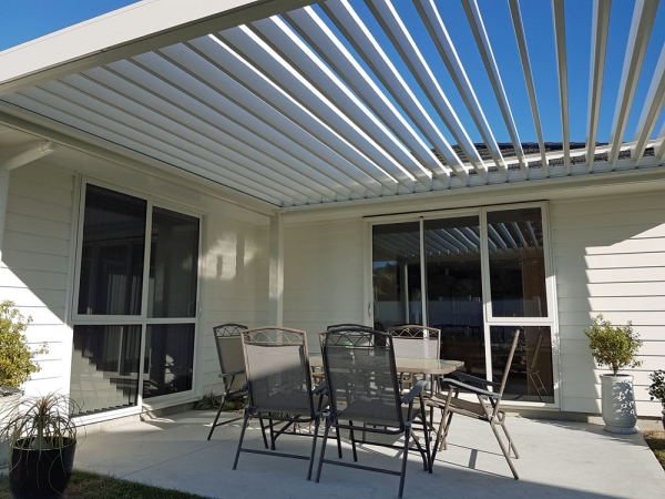 Freestanding Bask Louvre Roof Fitted On North Facing Patio Open On Winters  Day To Let The
