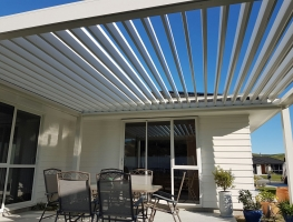 Freestanding Bask Louvre Roof fitted on North Facing Patio opened up to let the winter sun in